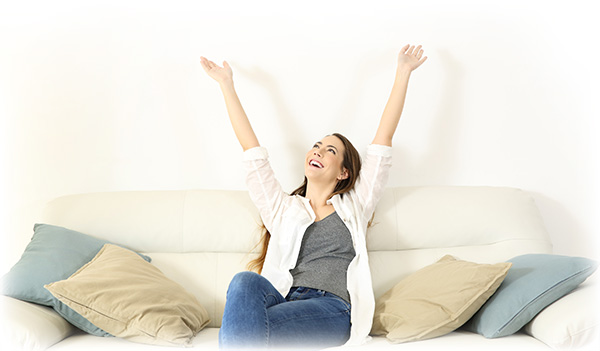 happy-woman-raising-arms-and-looking